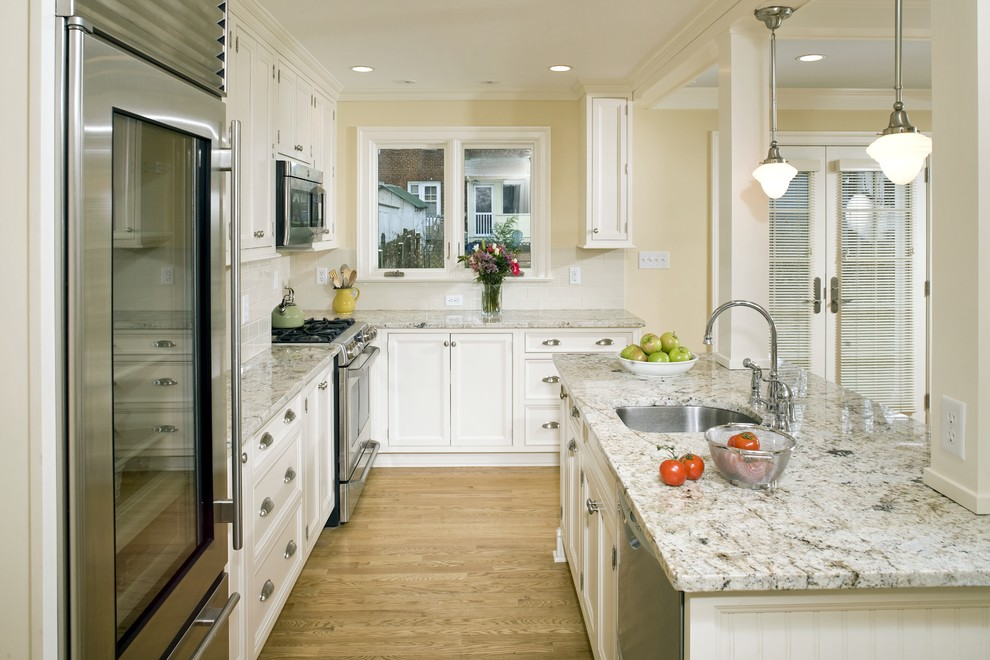 Kitchen - traditional kitchen idea in DC Metro with stainless steel appliances and granite countertops