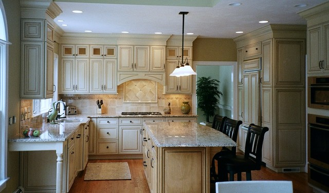 Almond glazed door stacked wall cabinets arched hearth for Almond colored kitchen cabinets