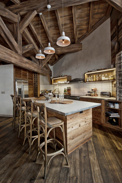 Eat-in kitchen - mid-sized rustic l-shaped dark wood floor eat-in kitchen idea in London with a farmhouse sink, marble countertops, beige backsplash and stainless steel appliances