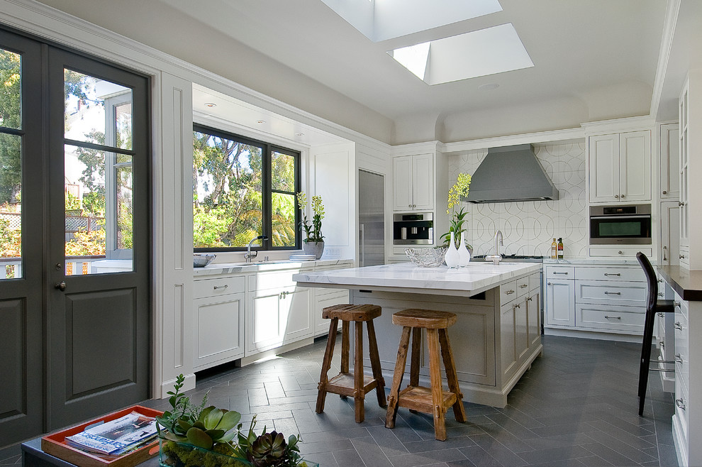 Inspiration for a transitional gray floor enclosed kitchen remodel in San Francisco with recessed-panel cabinets, white cabinets, marble countertops, white backsplash and stainless steel appliances