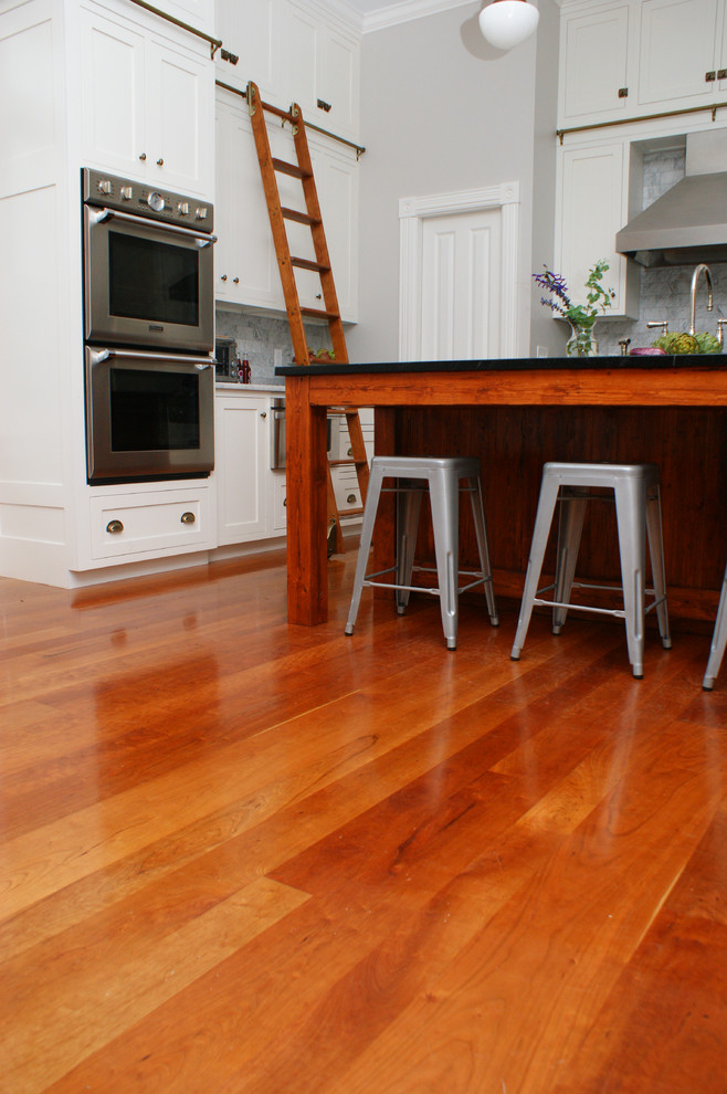 Inspiration for a contemporary medium tone wood floor kitchen remodel in Providence with stainless steel appliances and an island