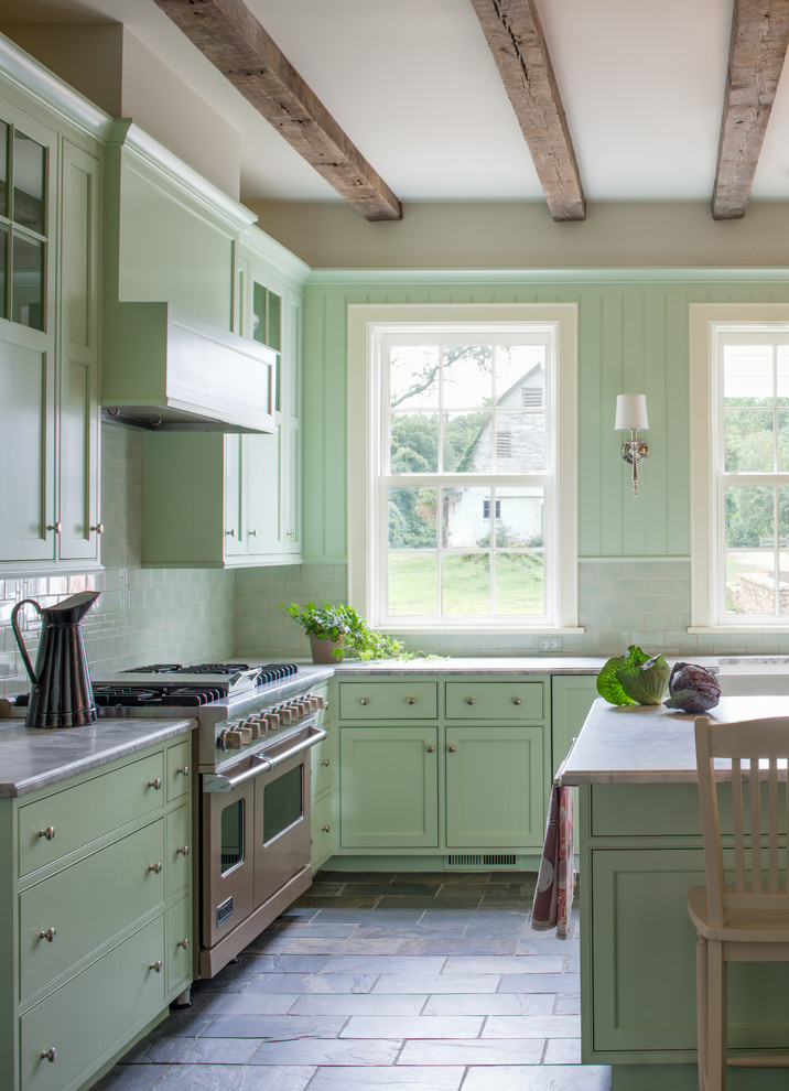 Inspiration for a farmhouse u-shaped slate floor eat-in kitchen remodel in DC Metro with flat-panel cabinets, green cabinets, marble countertops, green backsplash, subway tile backsplash and stainless steel appliances