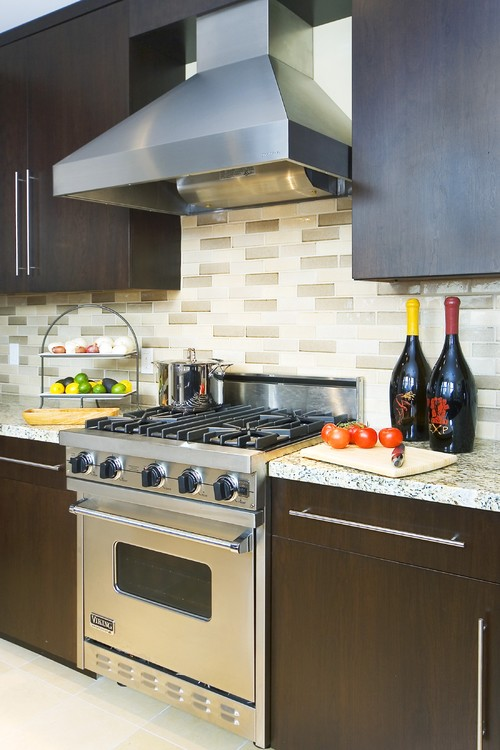 Backsplash with cherry cabinets & dark grey granite counter