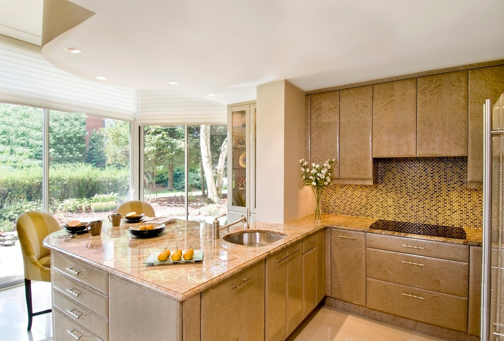 Transitional beige floor kitchen photo in Boston with an undermount sink, flat-panel cabinets, beige cabinets, granite countertops, multicolored backsplash, mosaic tile backsplash and stainless steel appliances