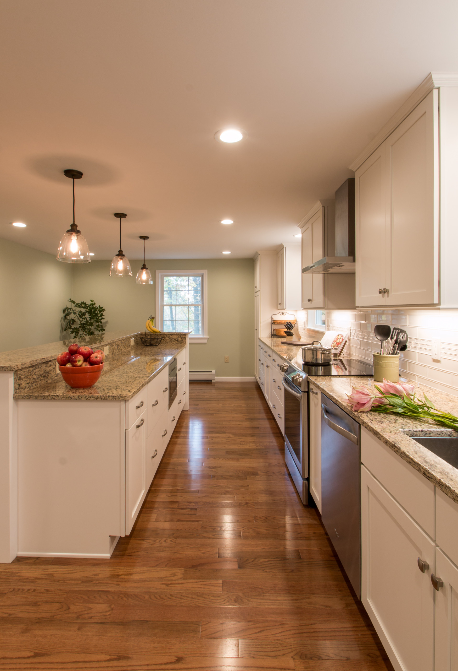 An efficient kitchen with a generous island is easy to work in with plenty of st