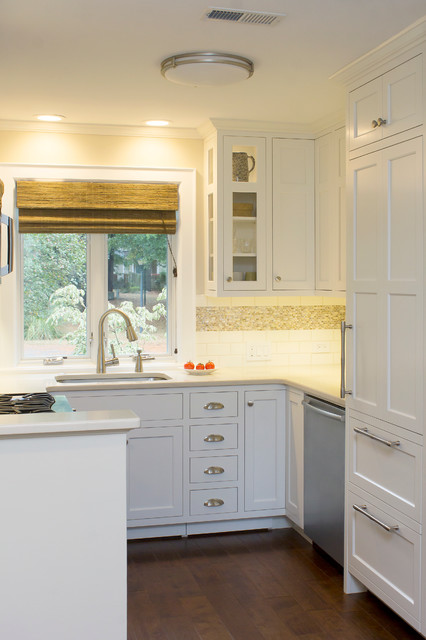 Example of a small transitional u-shaped dark wood floor and brown floor eat-in kitchen design in Raleigh with an undermount sink, recessed-panel cabinets, white cabinets, quartz countertops, white backsplash, subway tile backsplash, stainless steel appliances, no island and beige countertops