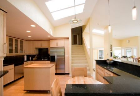 An open kitchen floor plan gaining all of its natural light from above transitional-kitchen