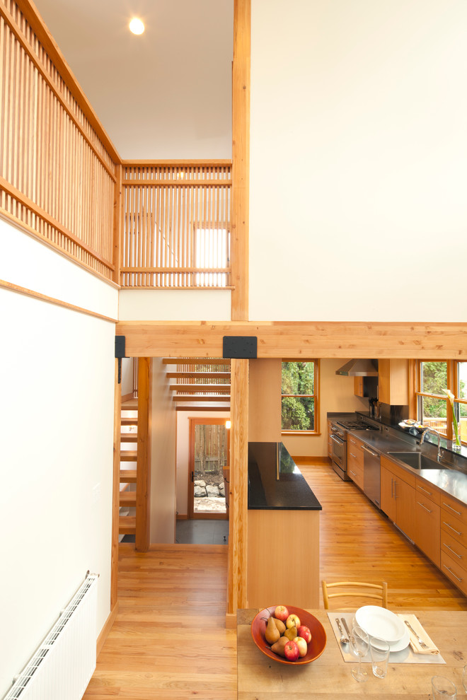 Trendy eat-in kitchen photo in Seattle with flat-panel cabinets and medium tone wood cabinets