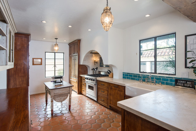 Awesome Tuscan Kitchen Photo In Los Angeles With A Farmhouse Sink, Medium Tone Wood  Cabinets And