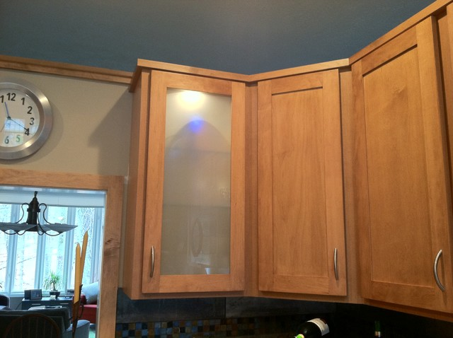 Angled wall cabinets in each corner added definition and for Angled kitchen cabinets