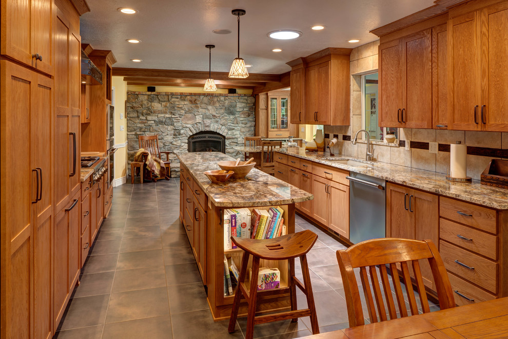Eat-in kitchen - rustic galley eat-in kitchen idea in Salt Lake City with an undermount sink, shaker cabinets, medium tone wood cabinets, beige backsplash and an island