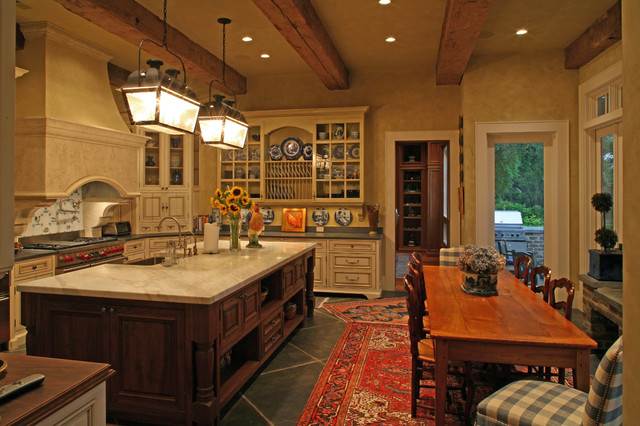 Antique pine table creates intimate eating area traditional kitchen