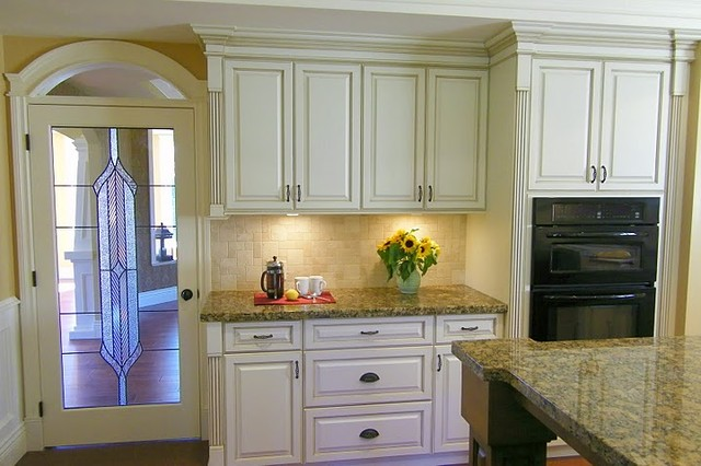 antiqued cream kitchen cabinets traditional kitchen