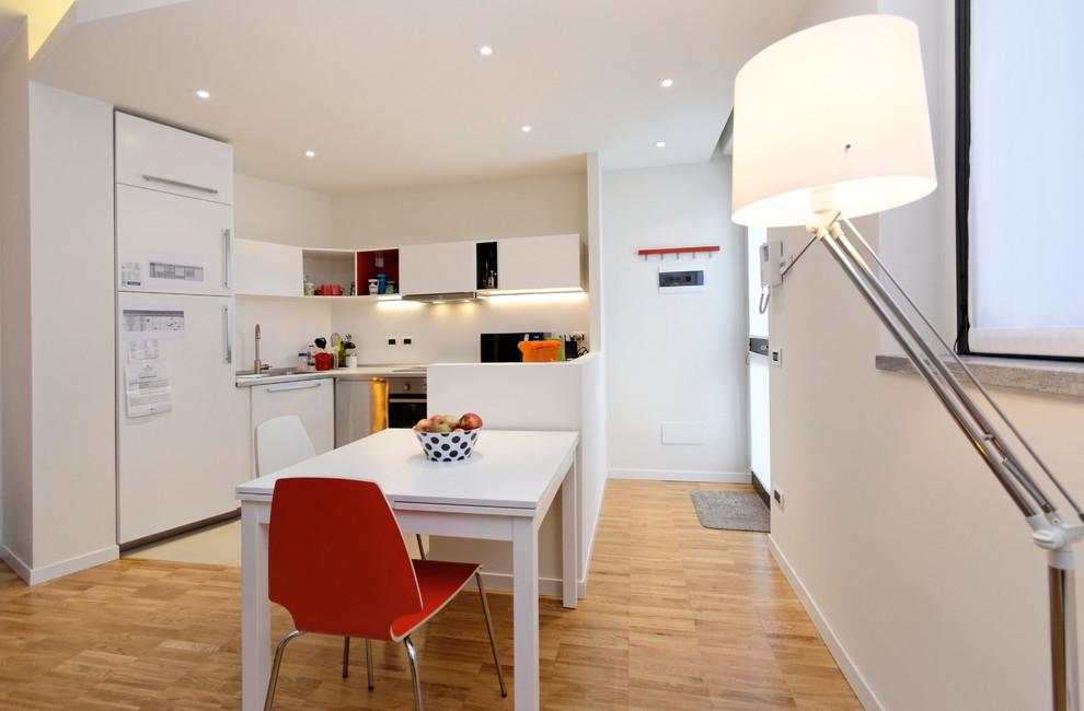 Small trendy light wood floor kitchen photo in Milan