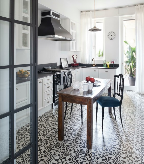 Appartamento newyorkese a milano country kitchen for Appartamento stile newyorkese