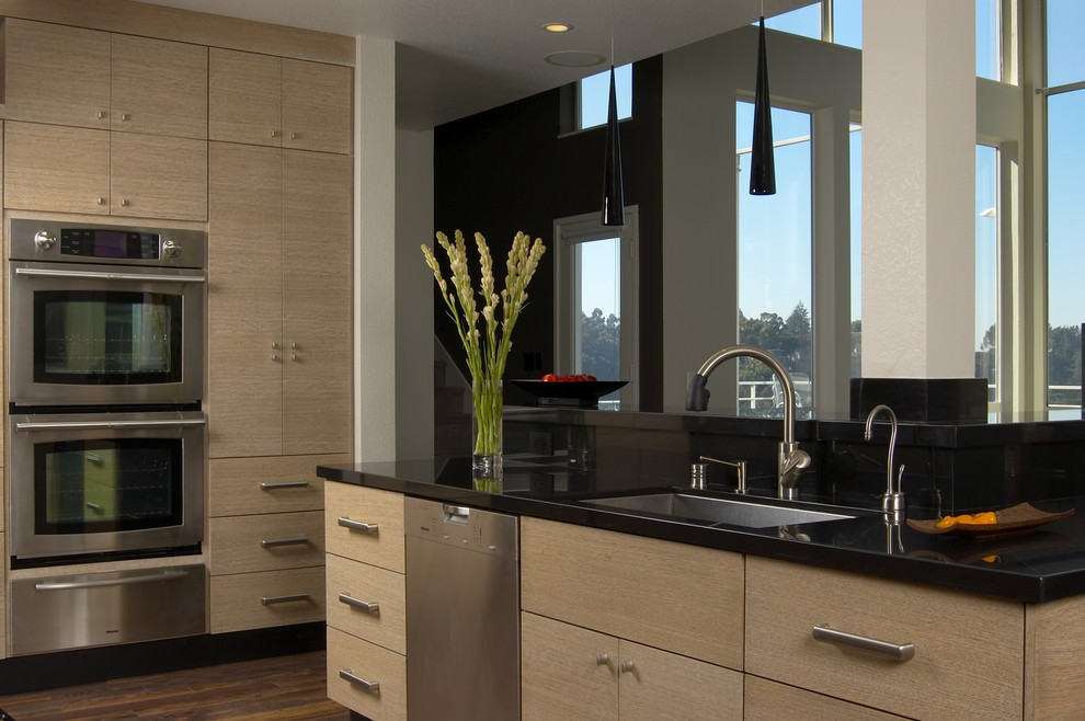 Kitchen - contemporary kitchen idea in San Francisco with flat-panel cabinets, an undermount sink, light wood cabinets, granite countertops and stainless steel appliances