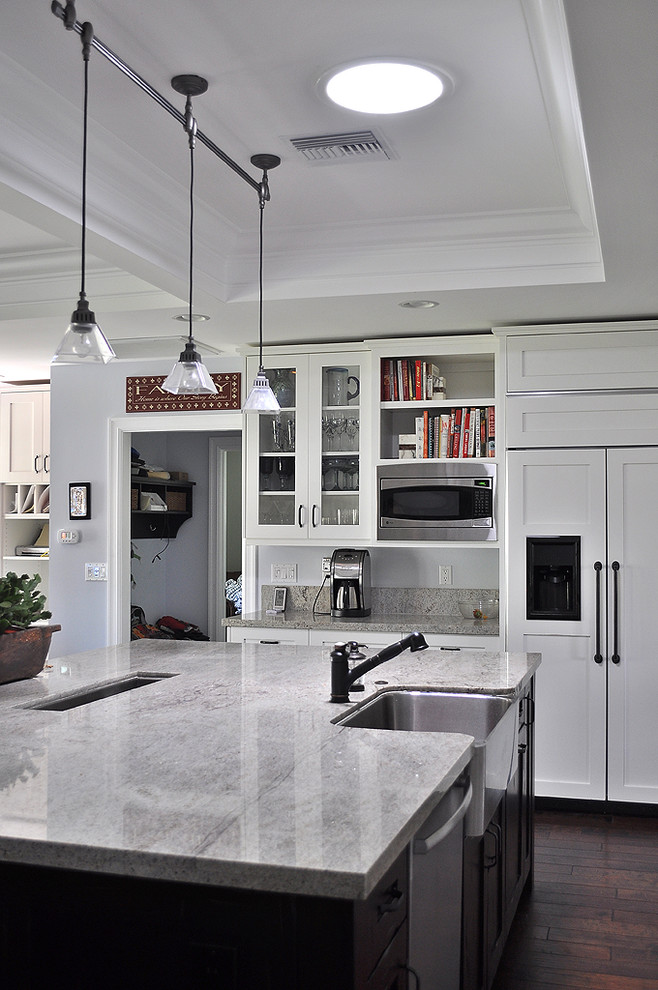 Kitchen - traditional kitchen idea in Phoenix with shaker cabinets, a farmhouse sink, white cabinets, granite countertops and paneled appliances