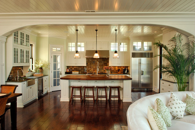Arch frames view to kitchen tropical kitchen charleston by