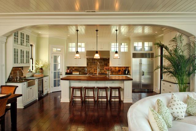 Arch frames view to kitchen tropical-kitchen