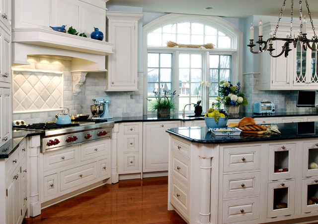 Arch top window over the kitchen sink and painted white inset cabinetry - Traditional - Kitchen ...