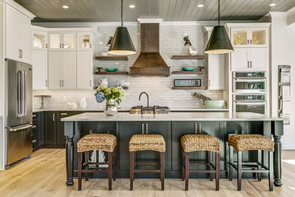 Inspiration for a cottage l-shaped light wood floor kitchen remodel in Other with marble countertops, white backsplash, stainless steel appliances, an island, white countertops, shaker cabinets, white cabinets and subway tile backsplash