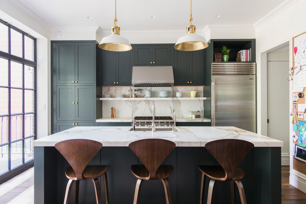 Mid-sized trendy galley medium tone wood floor and brown floor eat-in kitchen photo in Raleigh with an undermount sink, shaker cabinets, gray cabinets, stainless steel appliances, an island, marble countertops, gray backsplash and stone slab backsplash