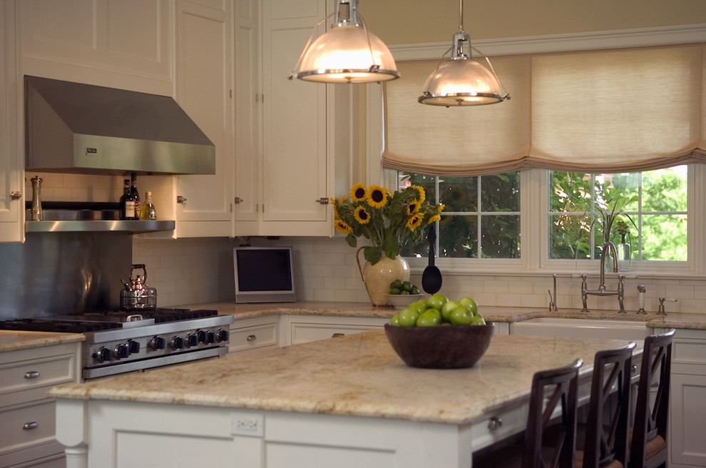 Inspiration for a timeless kitchen remodel in New York with recessed-panel cabinets, a farmhouse sink, white cabinets, white backsplash, subway tile backsplash and stainless steel appliances