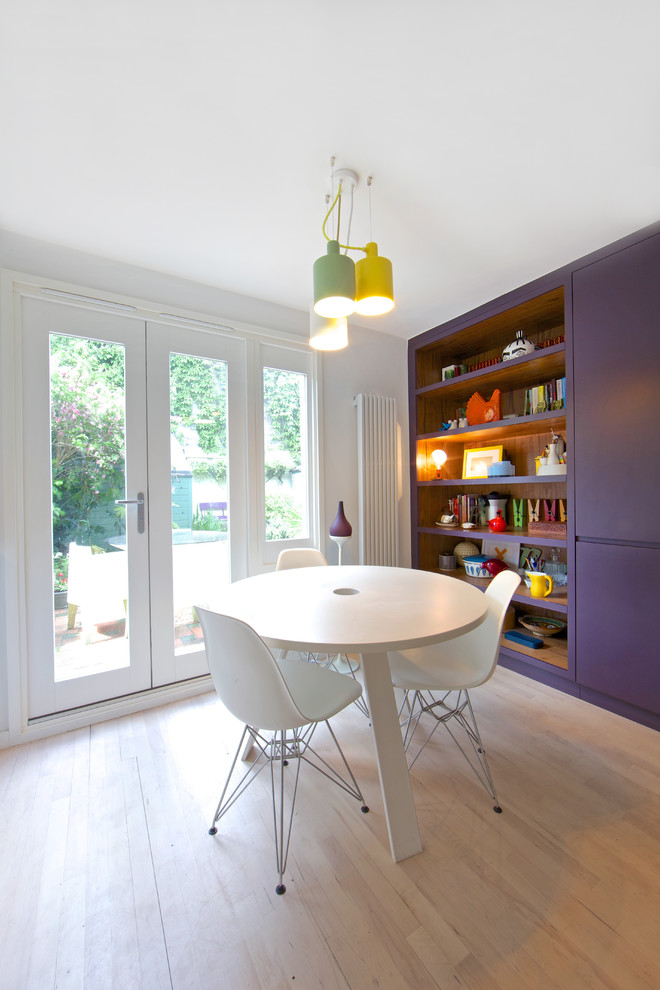 Eat-in kitchen - contemporary light wood floor eat-in kitchen idea in London with flat-panel cabinets and white cabinets