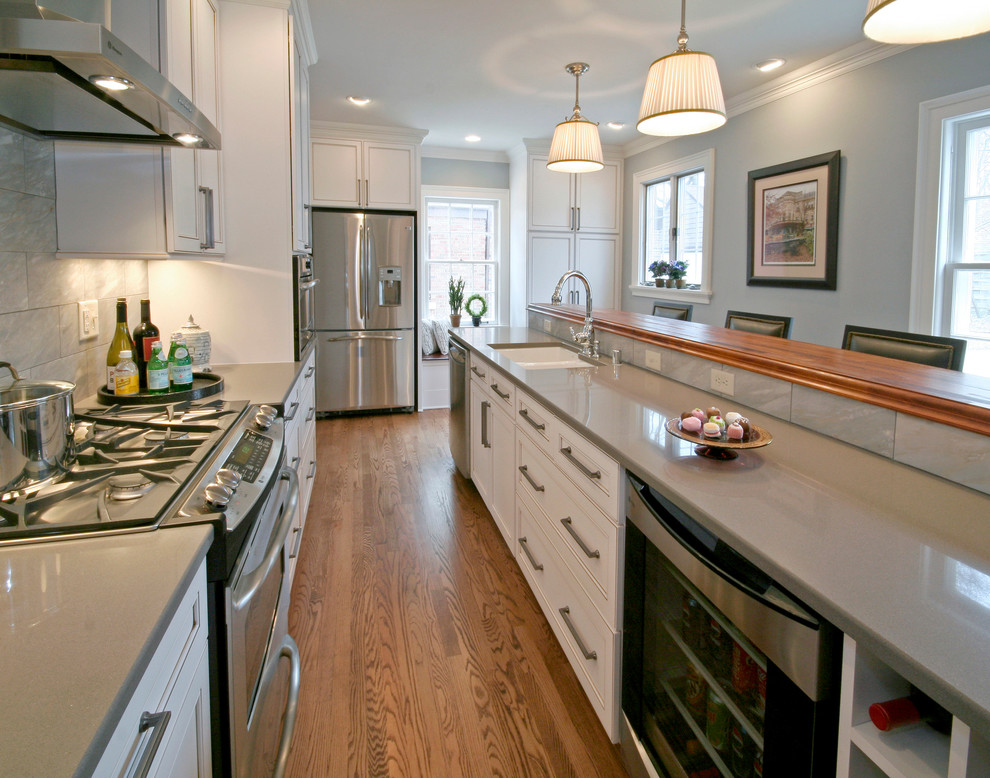 Kitchen - traditional kitchen idea in Milwaukee with stainless steel appliances, quartz countertops, a double-bowl sink and gray countertops