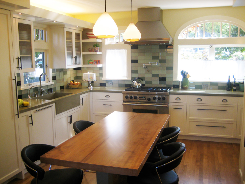 Mid-sized minimalist u-shaped medium tone wood floor eat-in kitchen photo in San Francisco with a single-bowl sink, recessed-panel cabinets, white cabinets, concrete countertops, glass tile backsplash, stainless steel appliances and two islands