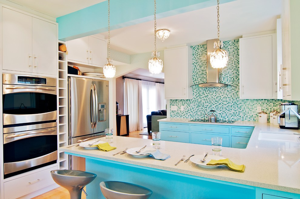 Example of a trendy u-shaped kitchen design in Chicago with stainless steel appliances, an undermount sink, flat-panel cabinets, white cabinets, mosaic tile backsplash and multicolored backsplash