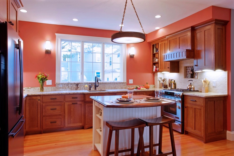 Kitchen - traditional kitchen idea in Boston with a single-bowl sink, medium tone wood cabinets, beige backsplash, stainless steel appliances and shaker cabinets