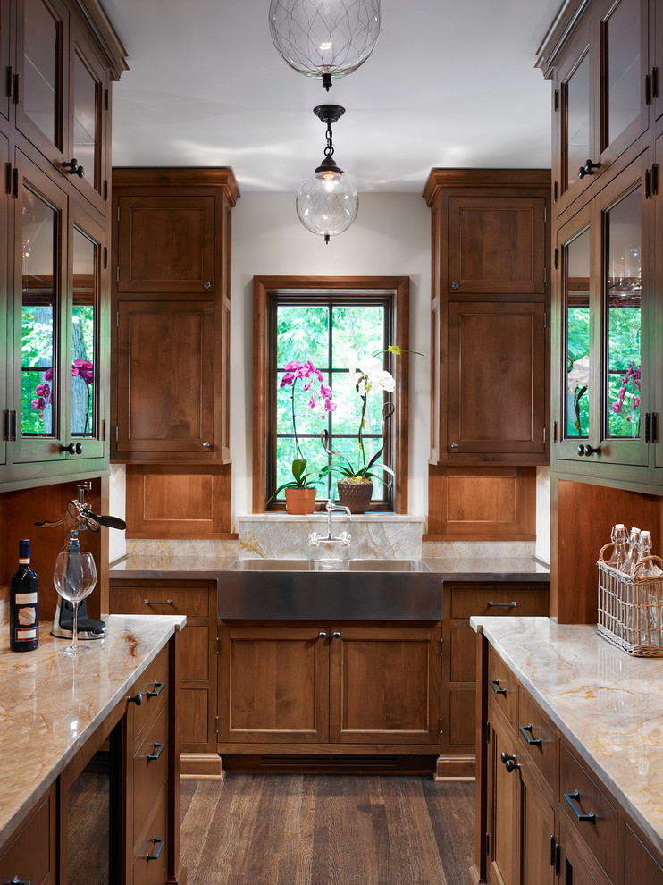 Example of a mid-sized classic galley medium tone wood floor kitchen pantry design in Chicago with a farmhouse sink, shaker cabinets, medium tone wood cabinets, quartzite countertops and no island