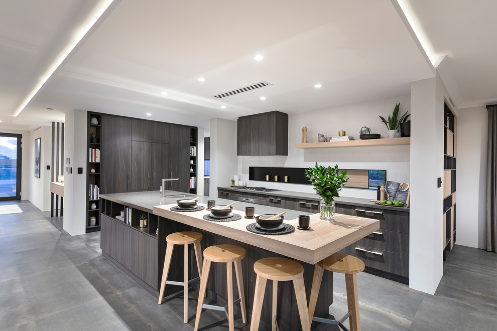 L-shaped gray floor eat-in kitchen photo in Perth with an undermount sink, flat-panel cabinets, gray cabinets, stainless steel appliances and an island