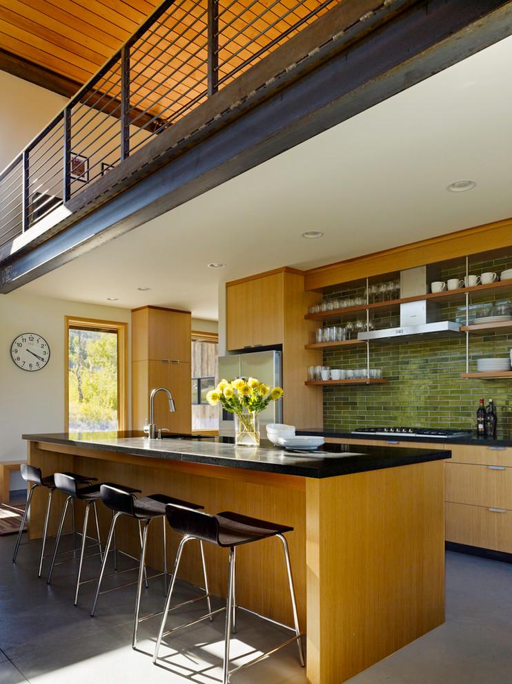 Kitchen - modern kitchen idea in Salt Lake City with medium tone wood cabinets, green backsplash, subway tile backsplash and stainless steel appliances