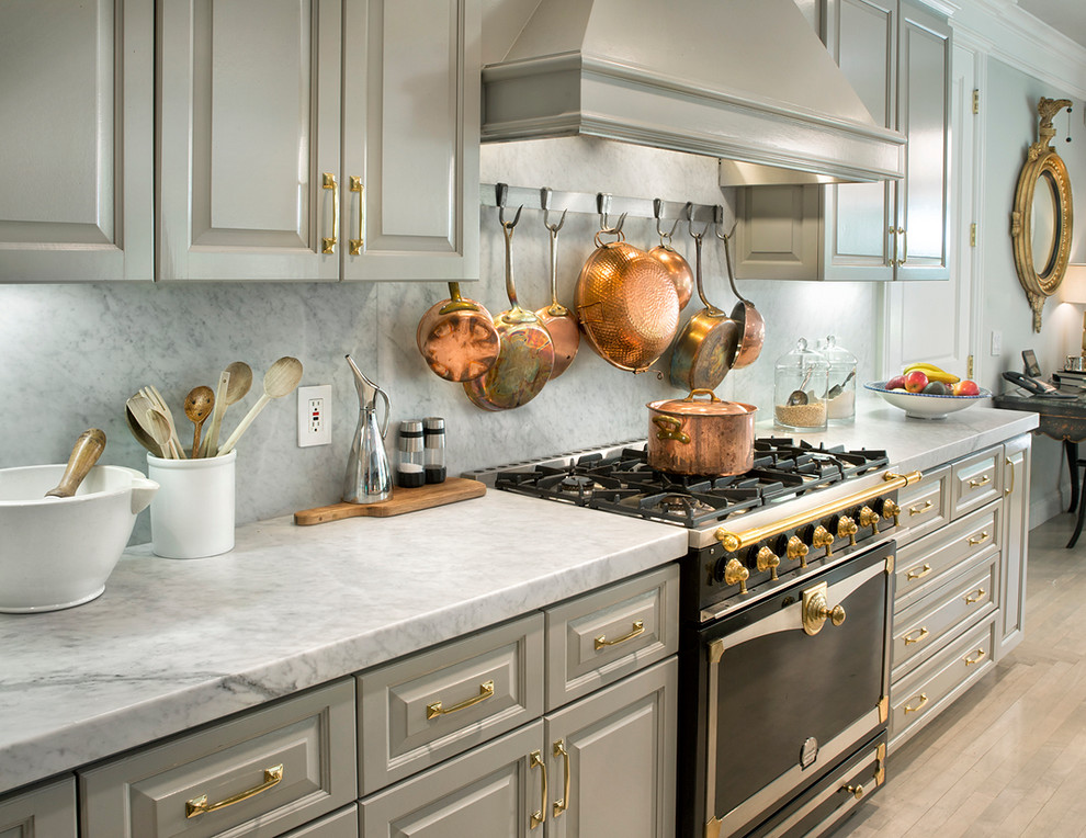 Transitional kitchen photo in Los Angeles with raised-panel cabinets, gray cabinets, white backsplash and black appliances