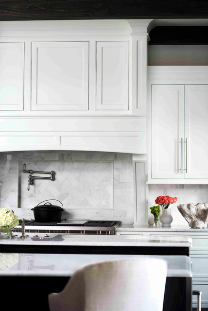 Kitchen - large transitional kitchen idea in Atlanta with recessed-panel cabinets, white cabinets, marble countertops and two islands