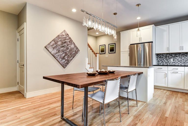Attached To A Small Work Island The Walnut Dining Table Is 30 High Tropical Kitchen Boston By Pfaff Color Design