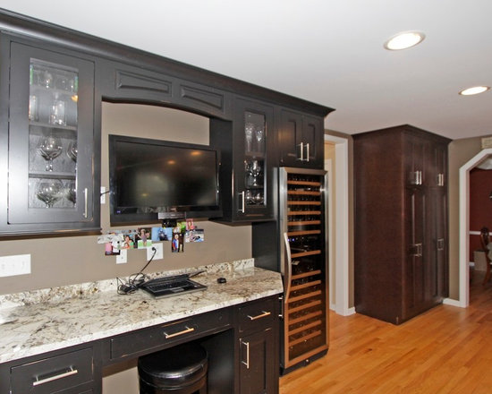 Dark Wood Cabinets, Stainless Steel Appliances and Beige Backsplash