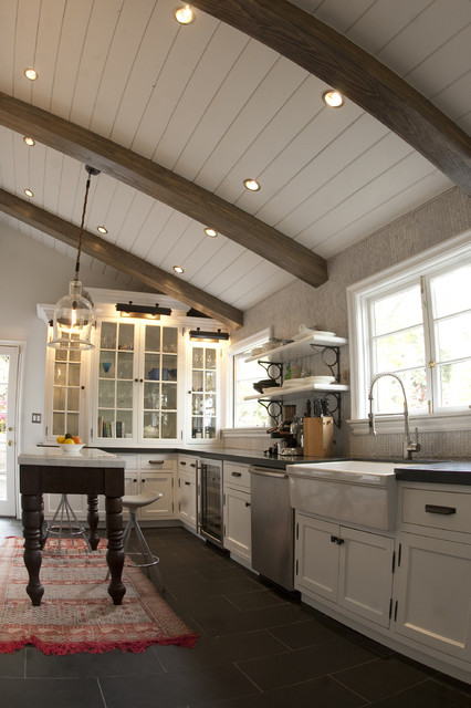 Example Of A Mountain Style Kitchen Design In Los Angeles With Glass Front Cabinets