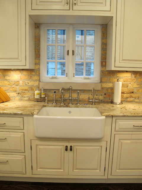 Award winning kitchen with brick backsplash chicago for Kitchen cabinets chicago