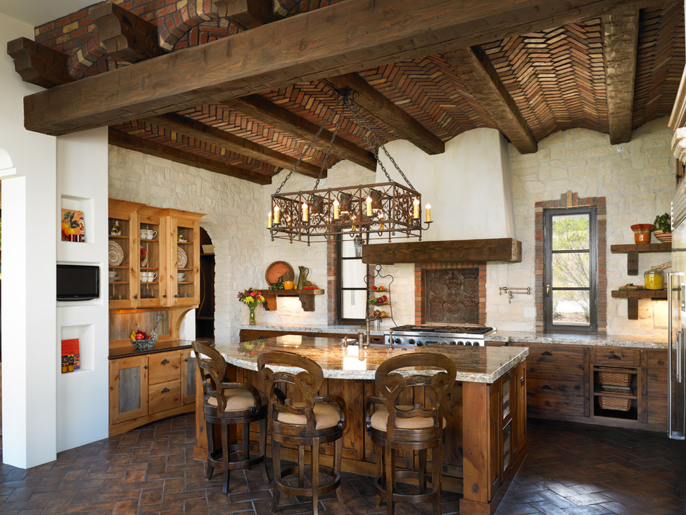 Inspiration for a mediterranean l-shaped kitchen remodel in Denver with distressed cabinets and stainless steel appliances