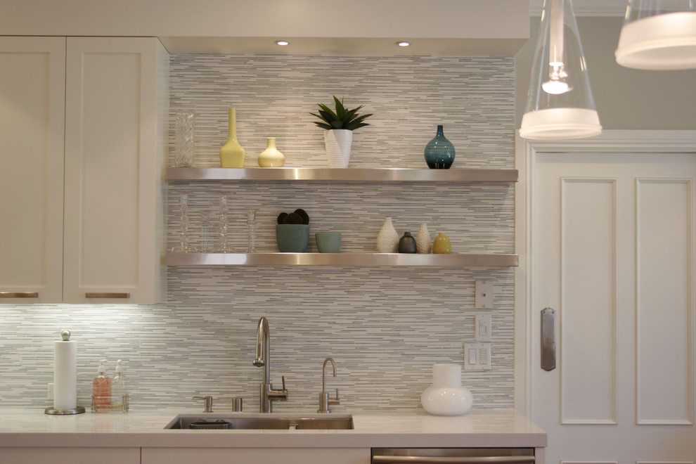 Eat-in kitchen - large contemporary l-shaped medium tone wood floor eat-in kitchen idea in San Francisco with matchstick tile backsplash, shaker cabinets, white cabinets, gray backsplash, stainless steel appliances, an undermount sink and solid surface countertops