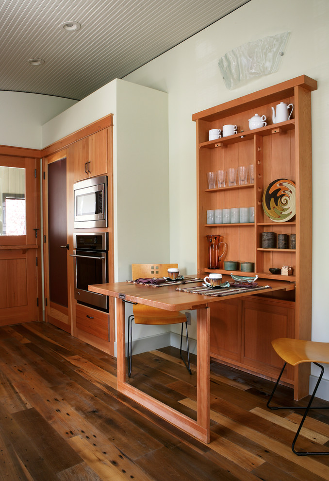 Eat-in kitchen - contemporary eat-in kitchen idea in Los Angeles with flat-panel cabinets and medium tone wood cabinets