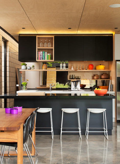Inspiration for a mid-sized contemporary galley concrete floor eat-in kitchen remodel in Melbourne with black cabinets, granite countertops, an island and flat-panel cabinets