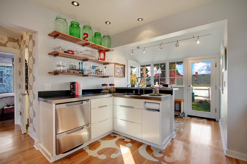 Inspiration for a contemporary kitchen remodel in Seattle with open cabinets