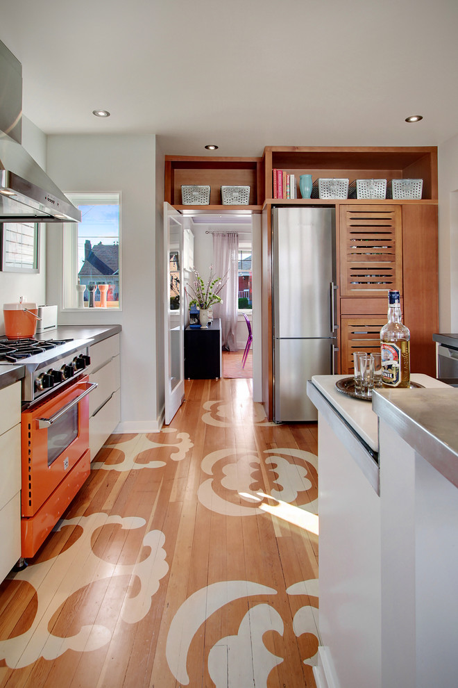 Trendy enclosed kitchen photo in Seattle with zinc countertops and colored appliances