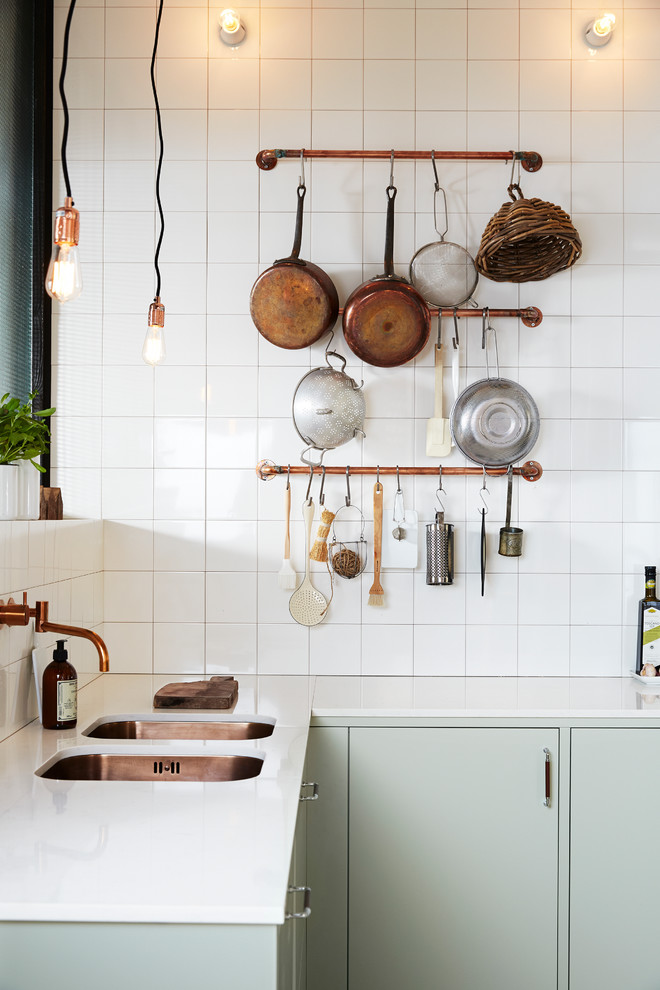 Small danish l-shaped kitchen photo in Malmo with a double-bowl sink, flat-panel cabinets, green cabinets, granite countertops and no island