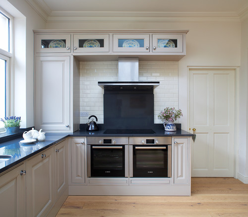 Are these wall ovens built into the lower cabinets? Many ...