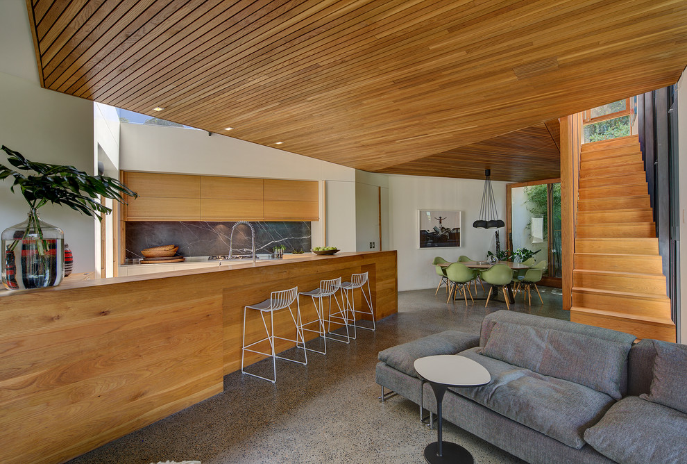 Inspiration for a contemporary open concept kitchen remodel in Sydney with flat-panel cabinets, medium tone wood cabinets, gray backsplash and an island